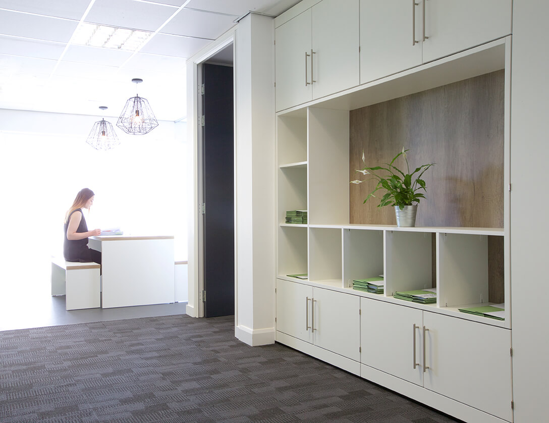 Room divider display with storage alcove