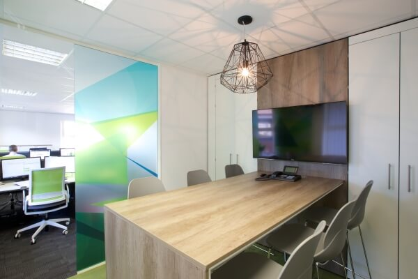 Room divider and media wall with ENVY meeting table